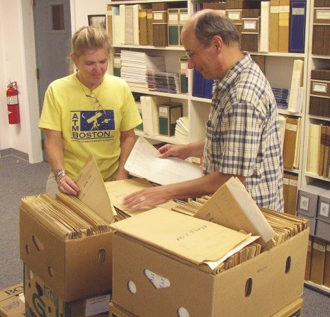 AAVSO staffers Ginny Renehan and Mike Saladyga inspect the newly-arrived RASNZ archive